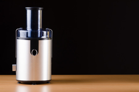 Juice extractor in kitchenware concept photo