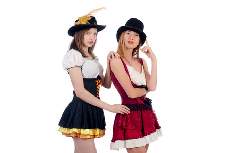 Girls in bavarian costumes isolated on white photo