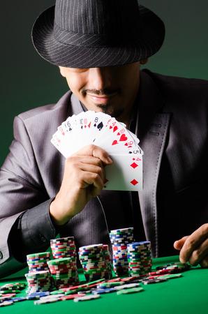 texas hold em: Man playing in dark casino