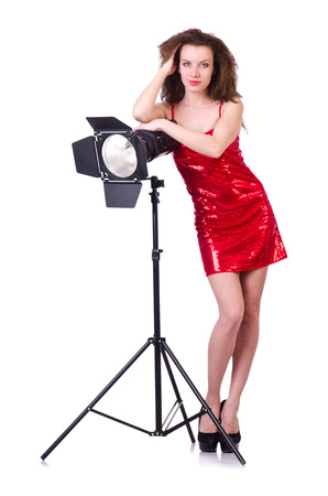 Woman in red dress posing in the studio photo