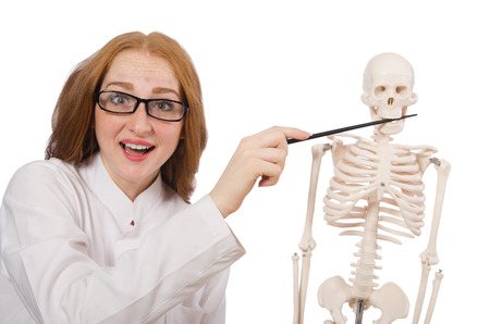 Young female doctor with skeleton isolated on white photo