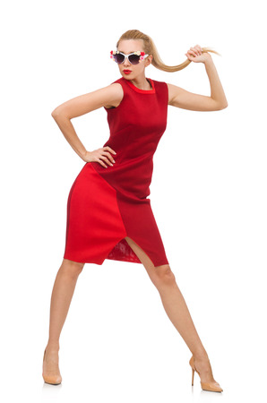 Pretty young woman in red dress isolated on white photo