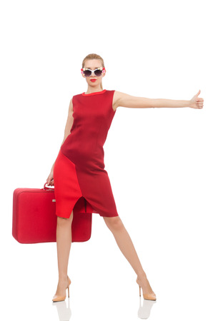 hitch hiker: Pretty young woman in red dress isolated on white