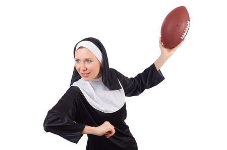 nun: Pretty nun with rugby ball isolated on white