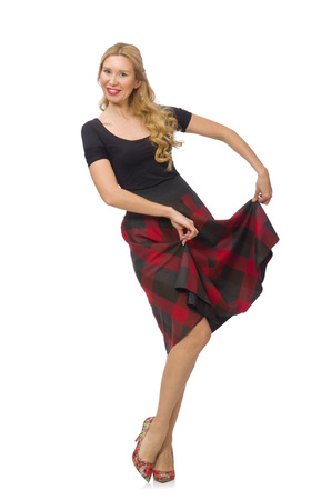 square dancing: Beautiful young woman in plaid dress isolated on white