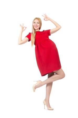 Pretty pregnant woman in red dress isolated on white photo