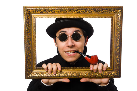 passepartout: Young man holding frame isolated on white