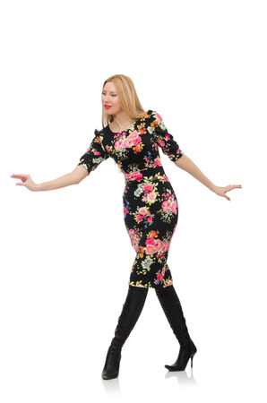 Cute blonde girl in floral dress isolated on white photo