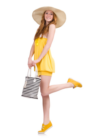 Young woman in yellow summer dress isolated on white photo