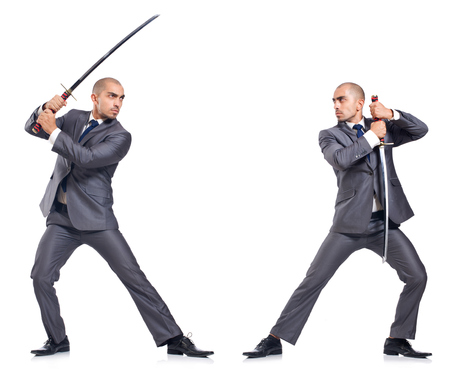 sword fighting: Two men figthing with the sword isolated on white
