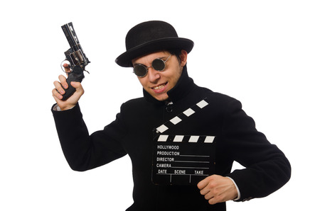 clapperboard: Young man with gun and clapper-board isolated on white