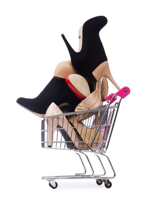 woman shopping cart: Woman shoes in shopping cart on white Stock Photo
