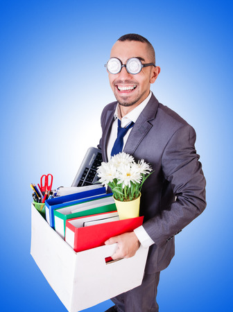lay off: Man being fired with box of personal stuff