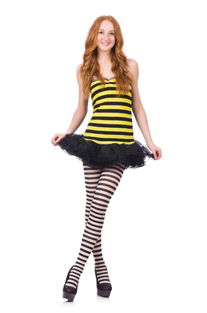 A girl in black and yellow striped dress isolated on white photo