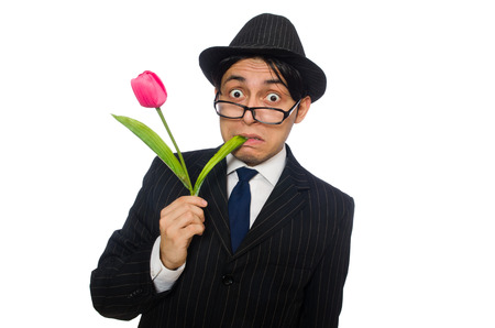 Young man in black costume with flower isolated on white photo