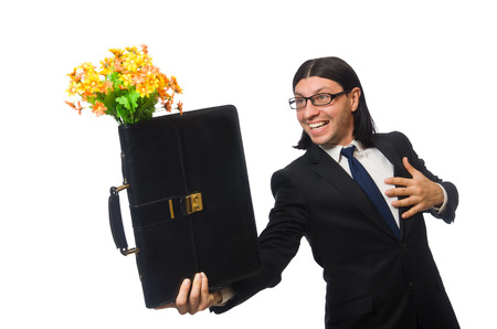 brief: Handsome businessman with flower and brief case isolated on white