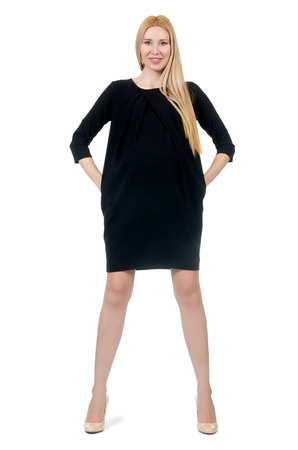 Pretty pregnant woman in mini black dress isolated on white Stock Photo