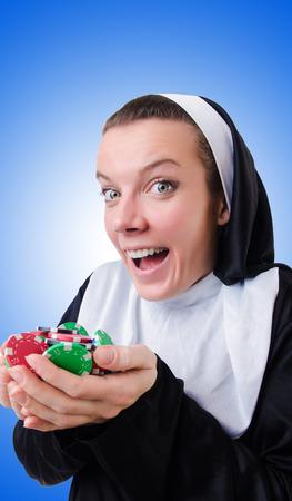 Nun in the gambling concept photo