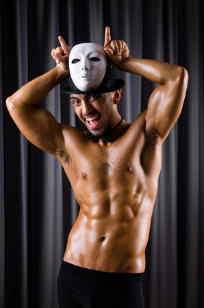 theatrical: Muscular actor with theatrical mask Stock Photo
