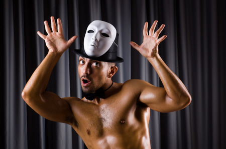 Muscular actor with theatrical mask photo