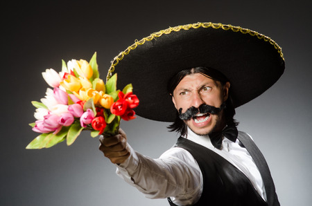 mexican background: Mexican man wears sombrero isolated on white Stock Photo