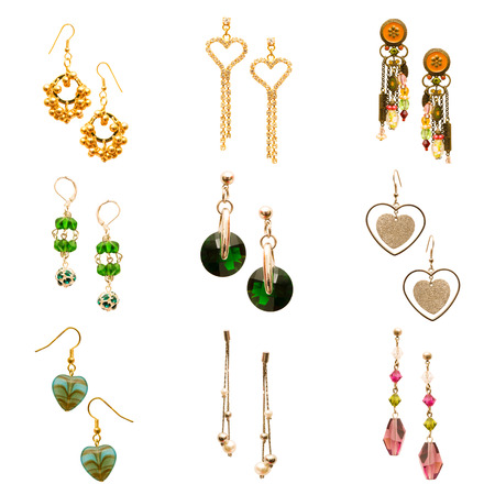 Set of various earrings isolated on white photo