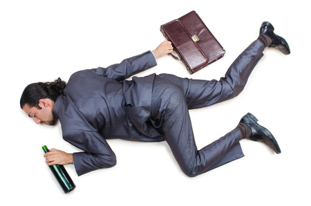 man resting: Businessman on the floor isolated on white Stock Photo