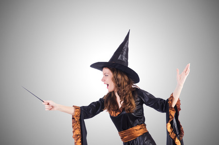 wicked witch: Witch with wand isolated on the white Stock Photo