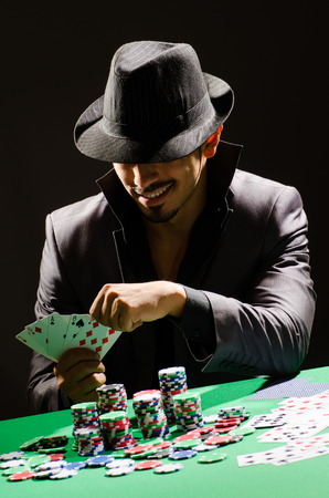 hold em: Man playing in dark casino