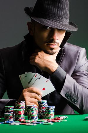 holdem: Man playing in dark casino