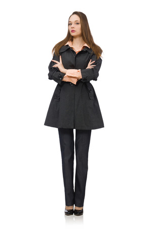 pret a porter: Cute girl in warm dark coat isolated on white Stock Photo