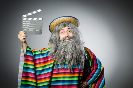 cowboy beard: Funny hairy mexican with movie clapper