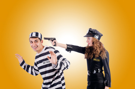 inmates: Police and prison inmate on white Stock Photo