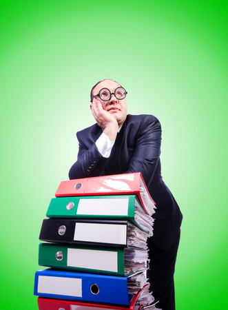 Funny man with lots of folders on white Stock Photo