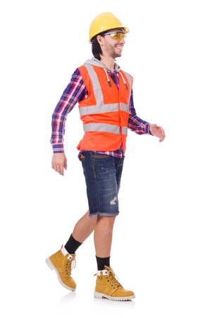 Walking young construction worker isolated on white