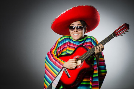 brandish: Man in red sombrero playing guitar