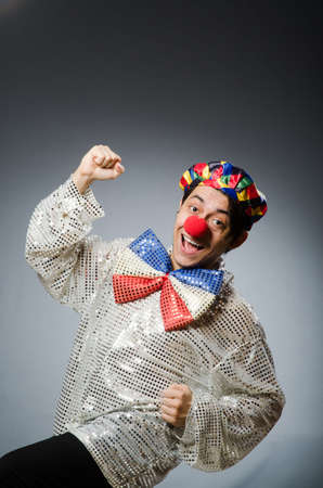 entertainers: Funny clown against dark background