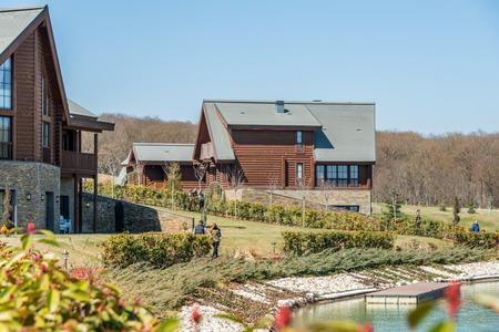 lake dwelling: Modern house near water on bright day