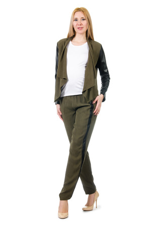 khaki pants: Pregnant woman in fashionable costume isolated on white