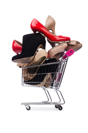 foot gear: Woman shoes in shopping cart on white Stock Photo