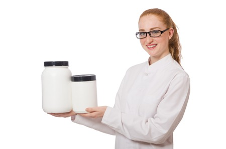 practioner: Young female doctor holding jar of protein isolated on white Stock Photo