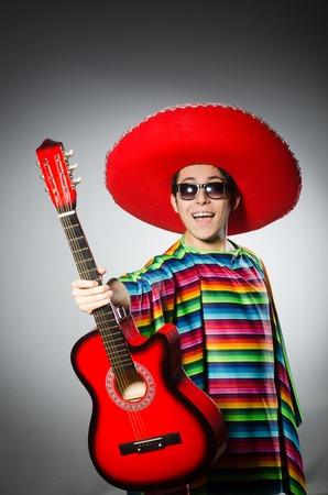 brandishing: Man in red sombrero playing guitar