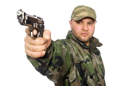 holding gun: Solider holding gun isolated on white