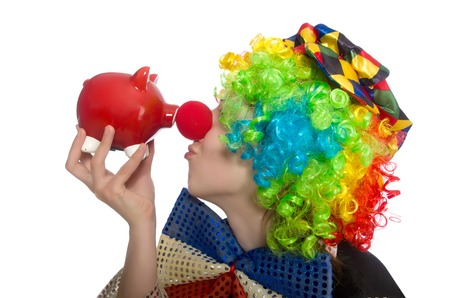 thrift box: Female clown with moneybox isolated on white