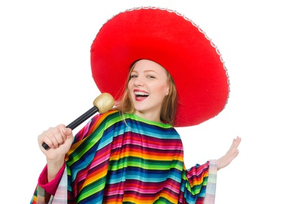 Pretty girl in mexican poncho singing isolated on white photo
