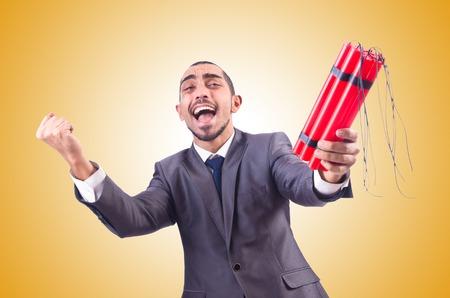 dinamita: Hombre de negocios con dinamita aislado en blanco