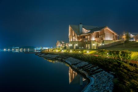 lake dwelling: Nice modern house near lake Stock Photo