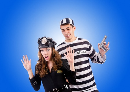 prisoner of love: Police and prison inmate on white Stock Photo
