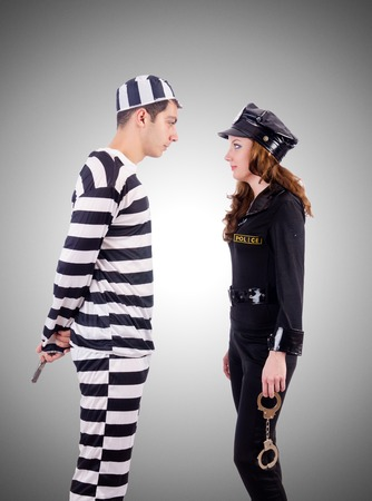 young  cuffs: Police and prison inmate on white Stock Photo