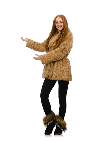 Redhead girl in fur coat isolated on white photo